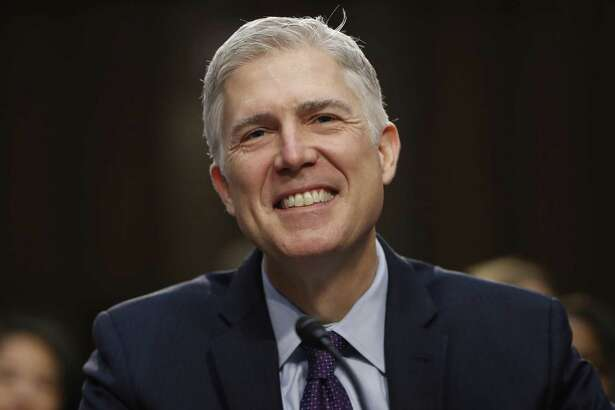 Supreme Court Justice nominee Neil Gorsuch smiles on Capitol Hill in Washington, during his confirmation hearing before the Senate Judiciary Committee on March 21.
