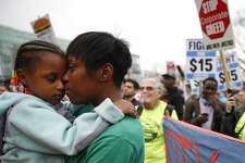 BOSTON - APRIL 14: Latrese Williams of Dedham snuggled with her daughter, Desirae Shealey, 4, at a rally against income inequality in Boston on April 14, 2015. (Photo by Jessica Rinaldi/The Boston Globe via Getty Images)