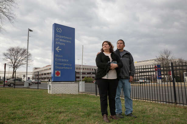 Army veteran Ricardo Pineda and Veronica Castro stand outside a VA hospital in Washington just before an appointment in March. Pineda left the Army because of medical problems after serving for six years. MUST CREDIT: Photo for The Washington Post by Griselda San Martin
