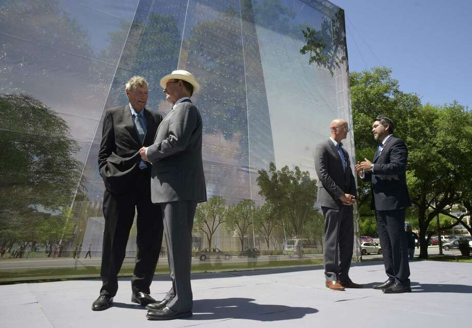 Tom Frost, chairman emeritus of Frost Bank, left, speaks with County Judge Nelson Wolff as City Councilman Roberto Treviño, right, speaks with Weston Urban CEO Randy Smith after a groundbreaking ceremony for the new Frost Bank tower. Photo: Billy Calzada /San Antonio Express-News / San Antonio Express-News