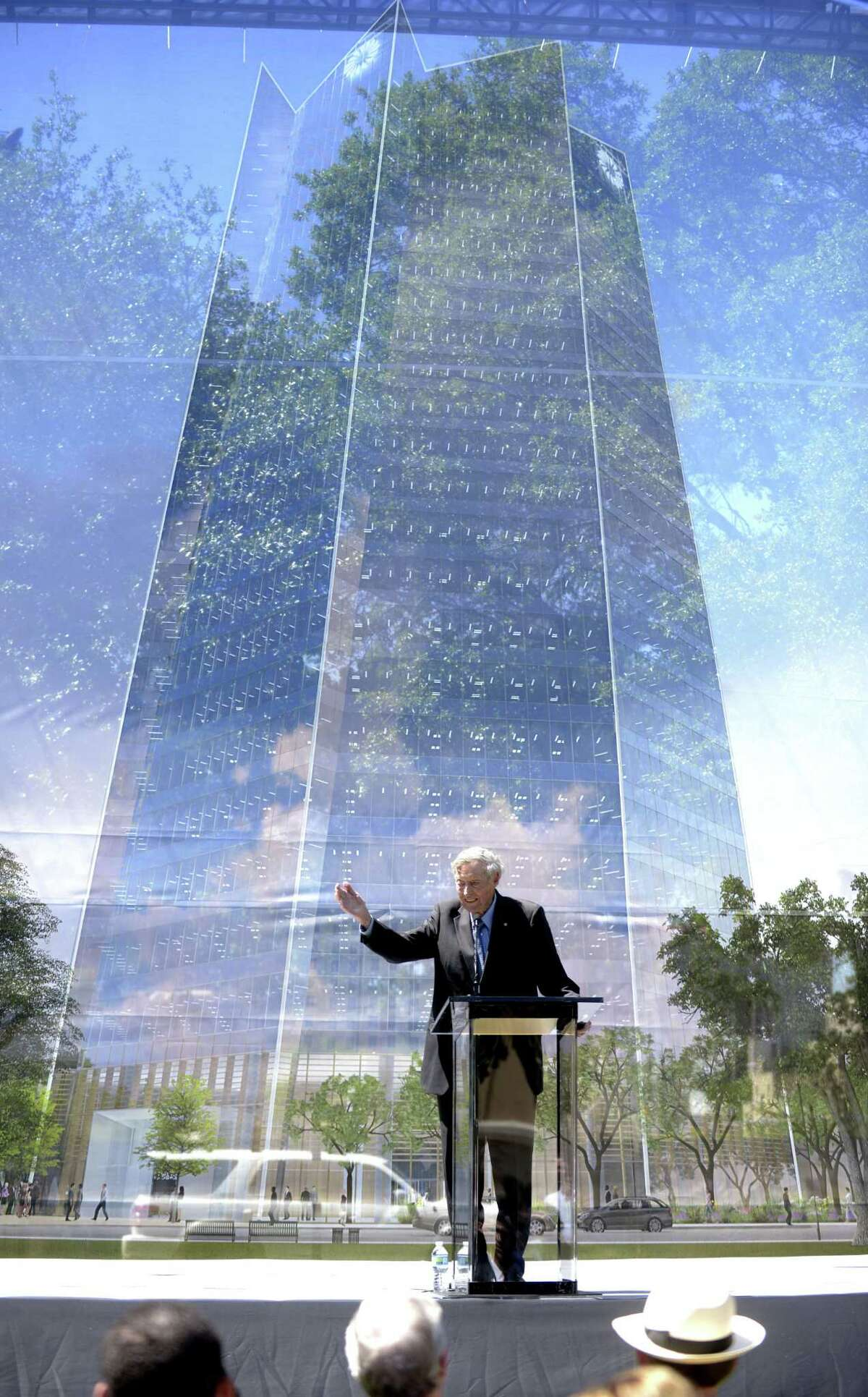 Tom Frost speaks on Wednesday in front of an image of the new Frost Tower.