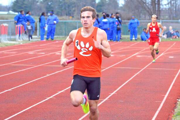 Edwardsville's Franky Romano competes in the first leg of the distance medley during the Southwestern Illinois Relays last Friday at EHS.