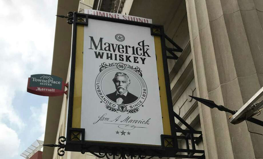 A sign tantilizes downtowners with the news that Maverick Whiskey is coming soon. The sign hangs over the old Antiques on Broadway space, right next door to the famous Paris Hatters shop. Photo: Emily Spicer / San Antonio Express-News