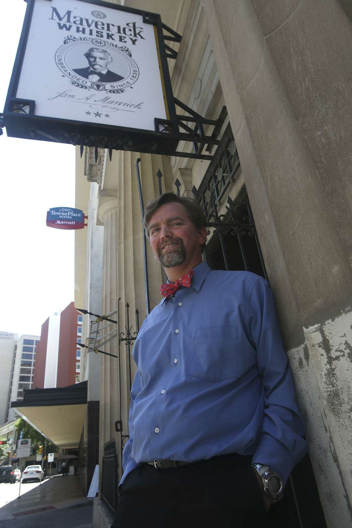 Kenneth Maverick stands in front of the old building in downtown San Antonio at 115 Broadway that he is converting to a microdistillery that will serve whiskey and offer a venue for sipping and swapping stories.