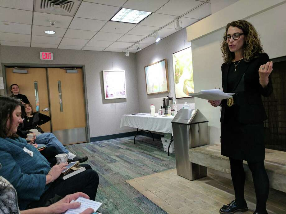 "Lisa Smith, author of ""Girl Walks Out of a Bar,"" speaks to an intimate group at the YWCA Greenwich about addiction. Photo: Jennifer Turiano /"