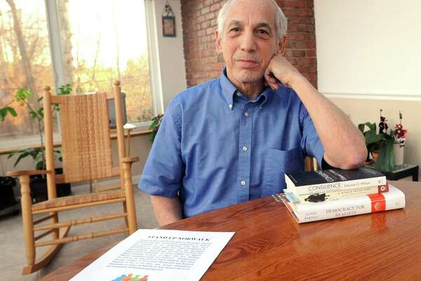 """Paul Cantor, who is spearheading the """"Stand Up Norwalk"""" petition effort talks about his resolution to protect undocumented immigrants and other Norwalk residents from discrimination while meeting at his home in Norwalk, Conn. on Tuesday, Dec. 27, 2016."""
