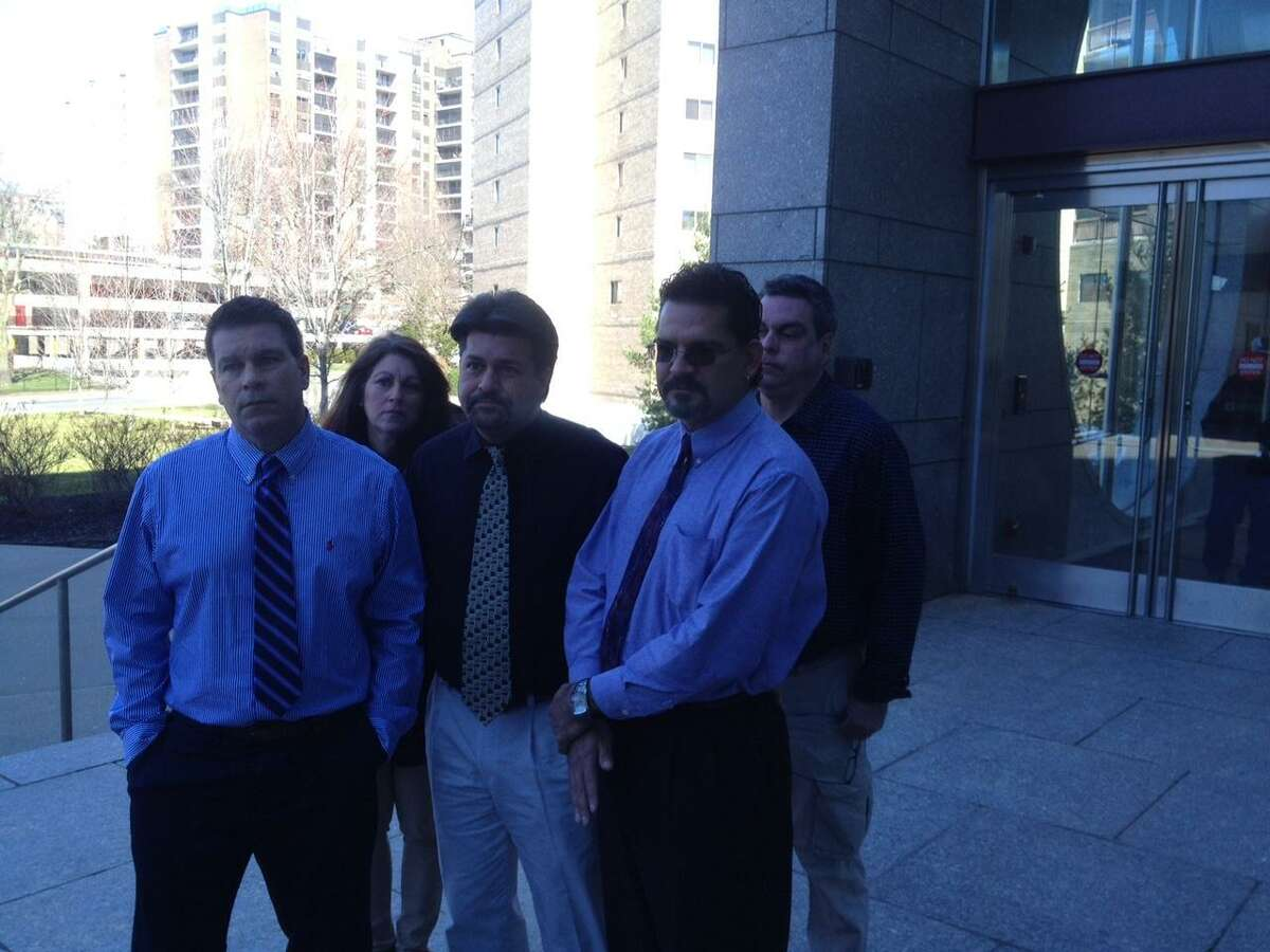From left, John Anderson, Patty Anderson Thomas Mollo-Hickey, Christopher Anderson and Jerry Anderson after finding out their brother Timothy Anderson had been found not guilty of killing their mother by by reason of insanity on Wednesday outside the Stamford courthouse.