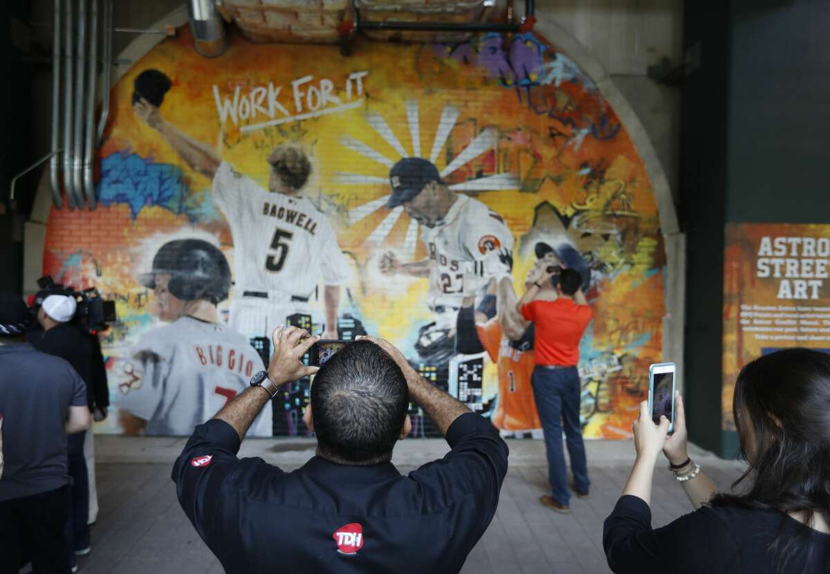 The unveiling of the Astros Street Art display in Home Run Alley, features the graffiti artwork of local artist Franky Cardona during the tour of the new center field at Minute Maid Park, Wednesday, March 29, 2017, in Houston. ( Karen Warren / Houston Chronicle )