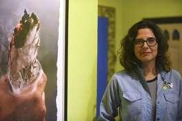 """Rebel Mariposa curated the exhibit """"Aqui Estamos y No Nos Vamos,"""" a new group exhibit at the Esperanza Center. Friday, March 24, 2017."""