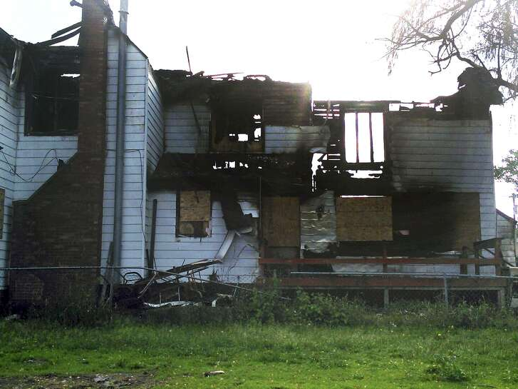 This 2014 photo shows the burned remains of Jaclyn Bentley's home in Clinton, Iowa. Bentley was acquitted in February of arson and insurance fraud charges, which she said stemmed from a flawed analysis of cellphone tower records. Despite acquittals like Bentley's and expert testimony that cellphone tower data should not be used to pinpoint people's locations, insurance companies continue to use the information to deny claims by casting doubt that customers were where they said they were.