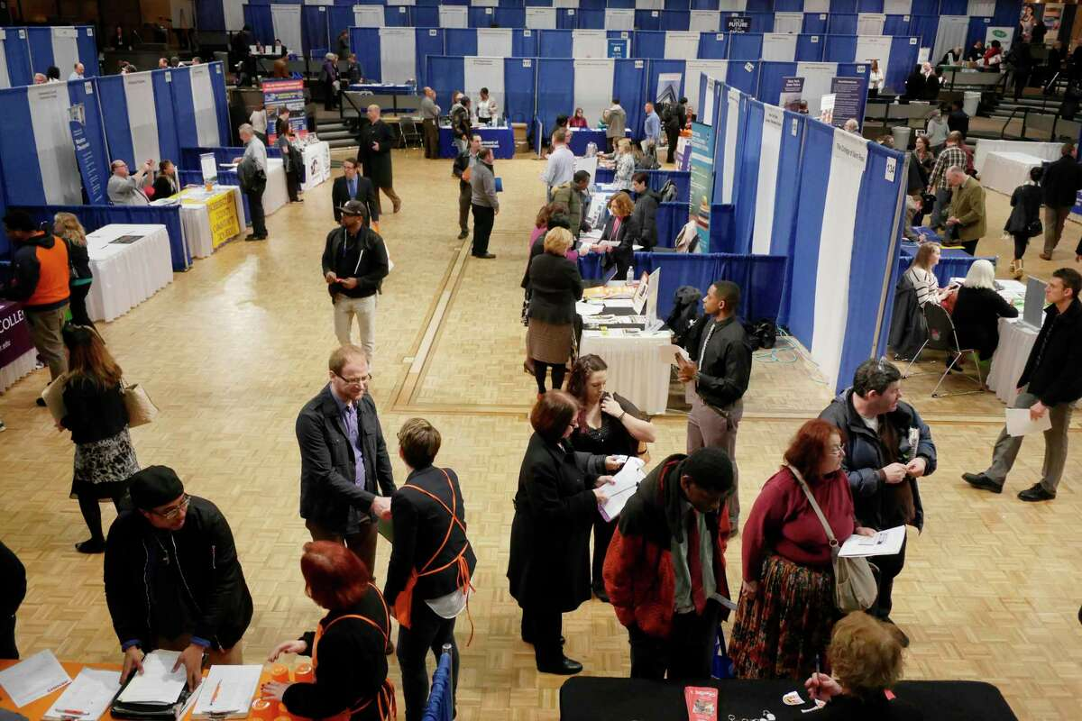 Job seekers make their way around to representatives from various companies at the 2017 Dr. King Career Fair at the Empire State Plaza Convention Center on Wednesday, March 29, 2017, in Albany, N.Y. (Paul Buckowski / Times Union)