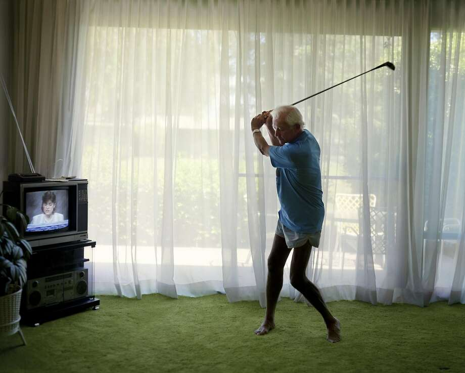 """Practicing Golf Swing"" is a 1986 chromogenic print among Larry Sultan's photos. His ""Here and Home"" show opens April 15 at the San Francisco Museum of Modern Art. Photo: Courtesy The Estate Of Larry Sultan"