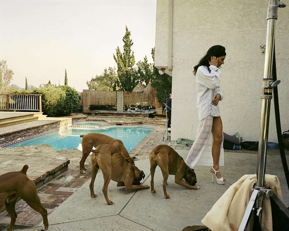 "Larry Sultan's ""Boxers, Mission Hills"" (1999) is from ""The Valley,"" a series of photos taken on porn movie sets in the San Fernando Valley. Photo: Courtesy The Estate Of Larry Sultan"
