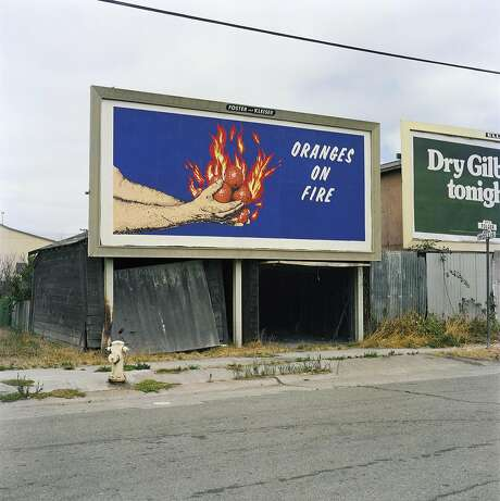 "A roadside photo mural by Larry Sultan and Mike Mandel, from 1975, is titled ""Oranges on Fire."" Photo: Courtesy The Estate Of Larry Sultan"