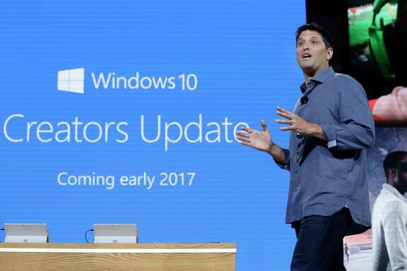 """FILE - In this Wednesday, Oct. 26, 2016, file photo, Terry Myerson, Microsoft's executive vice president of the Windows and Devices Group, discusses a Windows 10 update at a Microsoft media event in New York. The major update to Microsoft's Windows 10 system will start reaching consumers and businesses on April 11, 2017. New features in the """"Creators Update"""" include 3-D drawing tools, game-broadcasting capabilities and the ability to annotate maps and photos. Microsoft also is changing its update procedures to make them less disruptive. (AP Photo/Richard Drew, File)"""