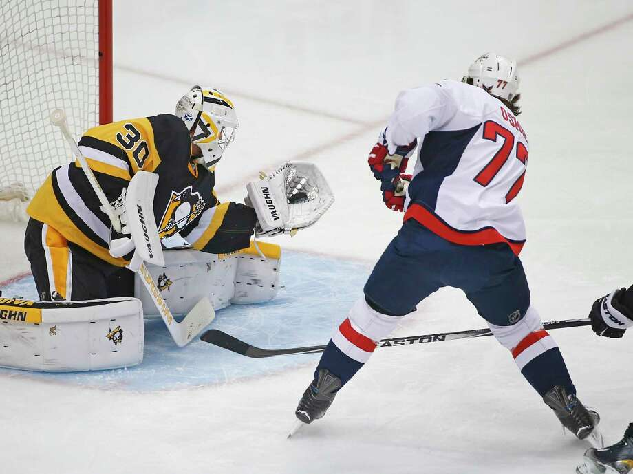Pittsburgh Penguins goalie Matt Murray (30) makes a save of a shot by Washington Capitals T.J. Oshie (77) during the first period of Game 3 in an NHL hockey Stanley Cup Eastern Conference semifinals in Pittsburgh, Monday, May 2, 2016. (AP Photo/Gene J. Puskar) Photo: Gene J. Puskar, STF / AP