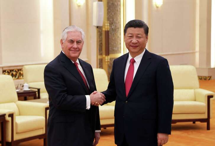 U.S. Secretary of State Rex Tillerson is welcomed by Chinese President Xi Jining before their bilateral meeting at the Great Hall of  the People on March 19 in Beijing. (Glenn Johnson/Planet Pix/ZUma Press/TNS)