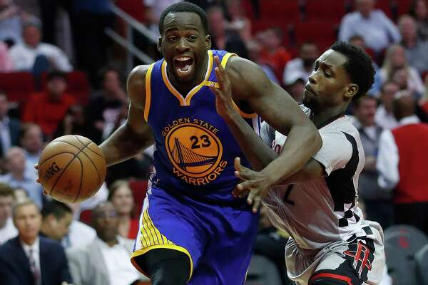 Golden State Warriors forward Draymond Green (23) drives to the basket against Houston Rockets guard Patrick Beverley (2)during the second half of an NBA basketball game at the Toyota Center, Tuesday, March 28, 2017, in Houston. ( Karen Warren / Houston Chronicle )