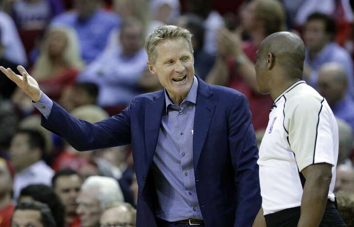 Golden State Warriors head coach Steve Kerr argues a foul call with official Tony Brown in the second half of an NBA basketball game against the Houston Rockets in Houston, Tuesday, March 28, 2017. (AP Photo/Michael Wyke)
