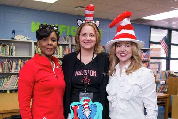 Sarah Joseph, Houston Rockets Director of Community Relations,Laurel D'Antoni andJulie Baker Finck, president of the Barbara Bush Houston Literacy Foundation.