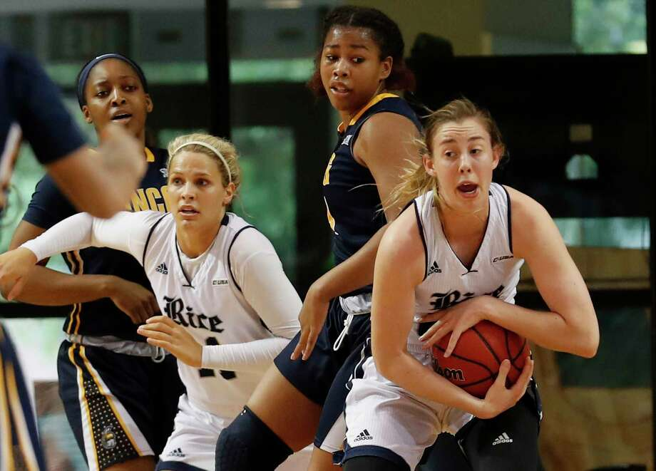 Rice Owls guard/forward Nicole Iademarco (22) secures a rebound in the first half during the Women's Basketball Invitational Championship Game between the UNC-Greensboro Spartans and the Rice Owls at Tudor Field House in Houston, TX on Sunday, March 26, 2017. Photo: Tim Warner, Freelance / Houston Chronicle