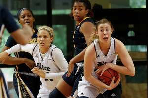 Rice Owls guard/forward Nicole Iademarco (22) secures a rebound in the first half during the Women's Basketball Invitational Championship Game between the UNC-Greensboro Spartans and the Rice Owls at Tudor Field House in Houston, TX on Sunday, March 26, 2017.