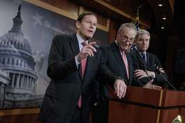 """From left, Sen. Richard Blumenthal, D-Conn., Senate Minority Leader Chuck Schumer, D-N.Y., and Sen. Sheldon Whitehouse, D-R.I., talk to reporters about so-called """"dark money"""" donor support of Supreme Court nominee Neil Gorsuch, on Capitol Hill in Washington, Wednesday, March 29, 2017. Blumenthal and Whitehouse are Judiciary Committee members."""