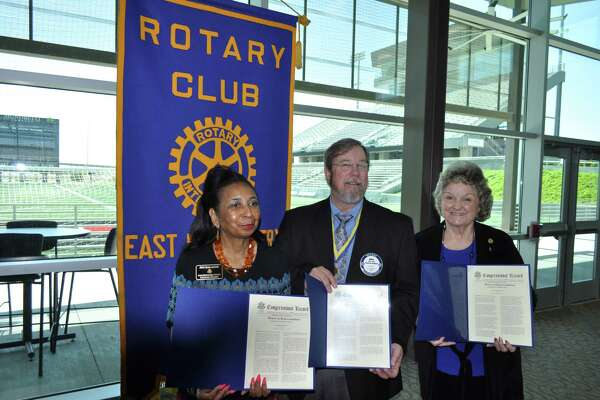 Current and charter members of the Rotary Club of East Montgomery County Rose Austin, Barbara Knox and Mike Smith receive Congressional Records from U.S. Congressman Kevin Brady during the Rotary Club of East Montgomery County 20th Anniversary Celebration at Texan Drive Stadium in Porter Saturday, March 25.