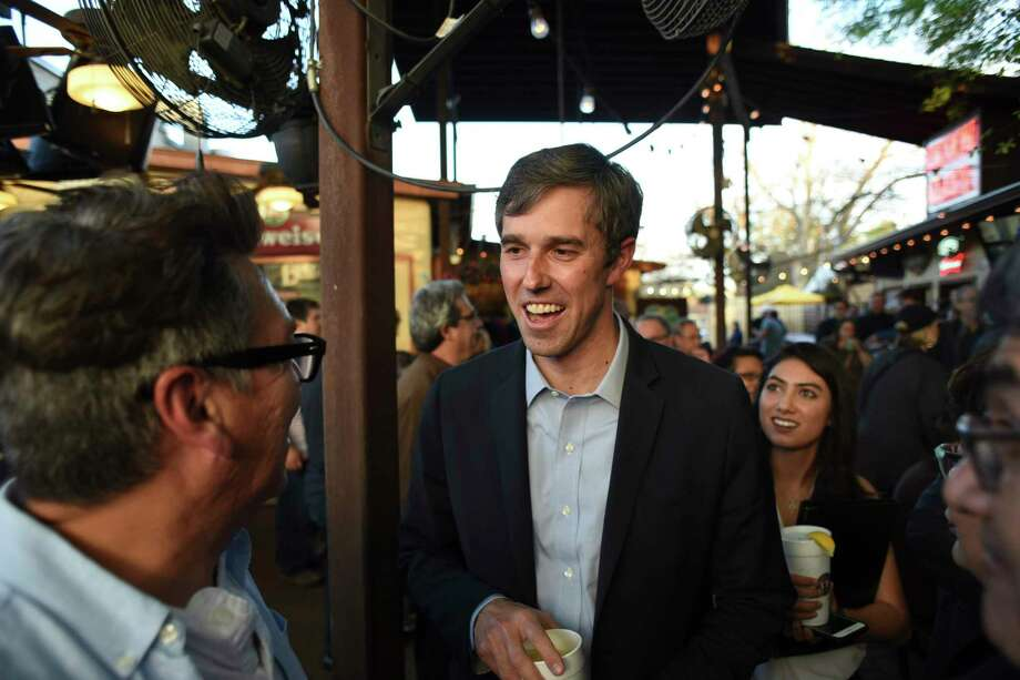U.S. Rep. Beto O'Rourke (D-El Paso) meets with people at Tycoon Flats in San Antonio on March 11, 2017. O'Rourke is a Democrat who is running against Republican Ted Cruz in 2018. Photo: Billy Calzada, Staff / San Antonio Express-News