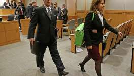 Special prosecutors Brian Wice (left) and Nicole DeBorde leave a courtroom after a Texas Attorney General Ken Paxton's hearing at Collin County Courthouse in McKinney, Texas, Thursday, Feb. 16, 2017. (Jae S. Lee/The Dallas Morning News)