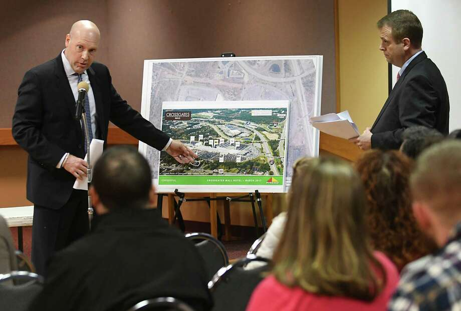 James Soos, left, and David Aitken of Pyramid Management Group present renderings of a proposed Crossgates Hotel project at a public hearing at Guilderland Town Hall Wednesday, March 29, 2017 in Guilderland, N.Y. (Lori Van Buren / Times Union) Photo: Lori Van Buren / 20040107A