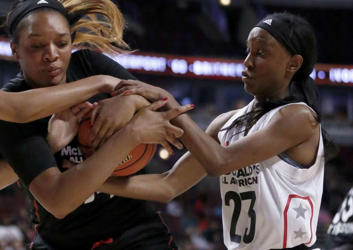 """Big West's Kiana Williams (23), a former Wagner star, battles the Big East's Kasiyahna """"Kasi"""" Kushkituah for the ball during the first half of the McDonald's All-American Basketball Game on March 29, 2017, in Chicago."""