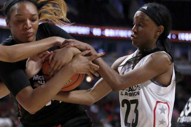 "Big West's Kiana Williams (23), a former Wagner star, battles the Big East's Kasiyahna ""Kasi"" Kushkituah for the ball during the first half of the McDonald's All-American Basketball Game on March 29, 2017, in Chicago."