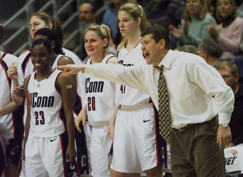 Connecticut coach Geno Auriemma yells directions as Connecticut players on the bench smile during the closing minutes of the Connecticut-Boston College Big East Conference game at Storrs, Conn., Wednesday, Jan. 26, 2000. Connecticut defeated Boston College 84-77. From left are: Christine Rigby; Kennitra Johnson (23); Stacy Hansmeyer (20); Paige Sauer (41); Auriemma. (AP Photo/Bob Child)