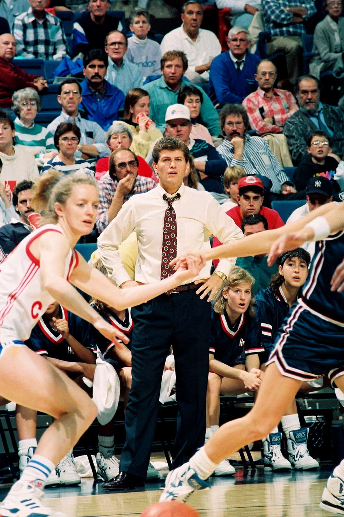 Italian-born American women's basketball coach Geno Auriemma, of the University of Connecticut, paces the sidelines during a game against the Russian national team, Storrs, 1990.