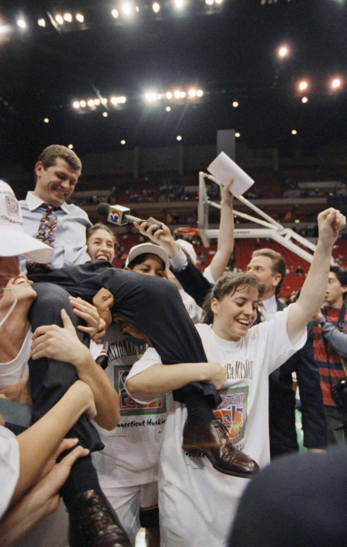 In this 1995 photo, Auriemma rides on the shoulders of his players after Connecticut beat Tennessee 70-64 to take the NCAA Womens Final Four Championship in Minneapolis, Minn. Auriemma and the UConn Huskies have turned women's college basketball into their own showcase. Over the past two decades, the Hall of Fame coach and his players have been the face of the sport, winning 11 championships and poised to make a run at a 12th title.