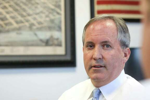 Texas Attorney General Ken Paxton talks with Jim Davis, deputy attorney general for civil litigation, in his office, Friday, Oct. 21, 2016, in Austin. ( Jon Shapley / Houston Chronicle )