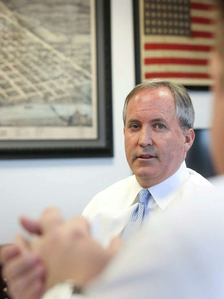 Texas Attorney General KenPaxtontalks with Jim Davis, deputy attorney general for civil litigation, in his office, Friday, Oct. 21, 2016, in Austin. ( JonShapley/ Houston Chronicle )