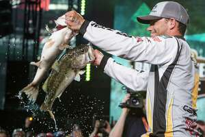 Jordan Lee, who won the 2017 Bassmaster Classic held on Lake Conroe, displays two of the five largemouth bass - totaling 27 pounds, 4 ounces - he caught off a submerged point in 5-6 feet of water on the final day of the professional bass fishing championship. Lee was one of only four anglers to hit the five fish daily limit.