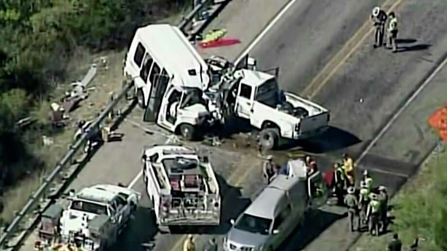 In this aerial image made from a video provided by KABB/WOAI authorities respond to a deadly crash involving a van carrying church members and a pickup truck on U.S. 83 outside Garner State Park in northern Uvalde County, Texas, Wednesday, March 29, 2017. The group of senior adults from First Baptist Church of New Braunfels, Texas, was returning from a retreat when the crash occurred, a church statement said. (KABB/WOAI via AP) SAN ANTONIO OUT Photo: AP / Courtesy KABB/WOAI