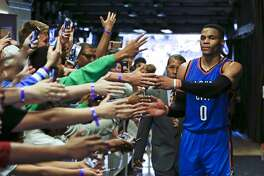 Oklahoma City Thunder's Russell Westbrook (0) is greeted by fans as he leaves the court after an NBA basketball game against the Orlando Magic, Wednesday, March 29, 2017, in Orlando, Fla. Oklahoma won 114-106 in overtime. (AP Photo/John Raoux)
