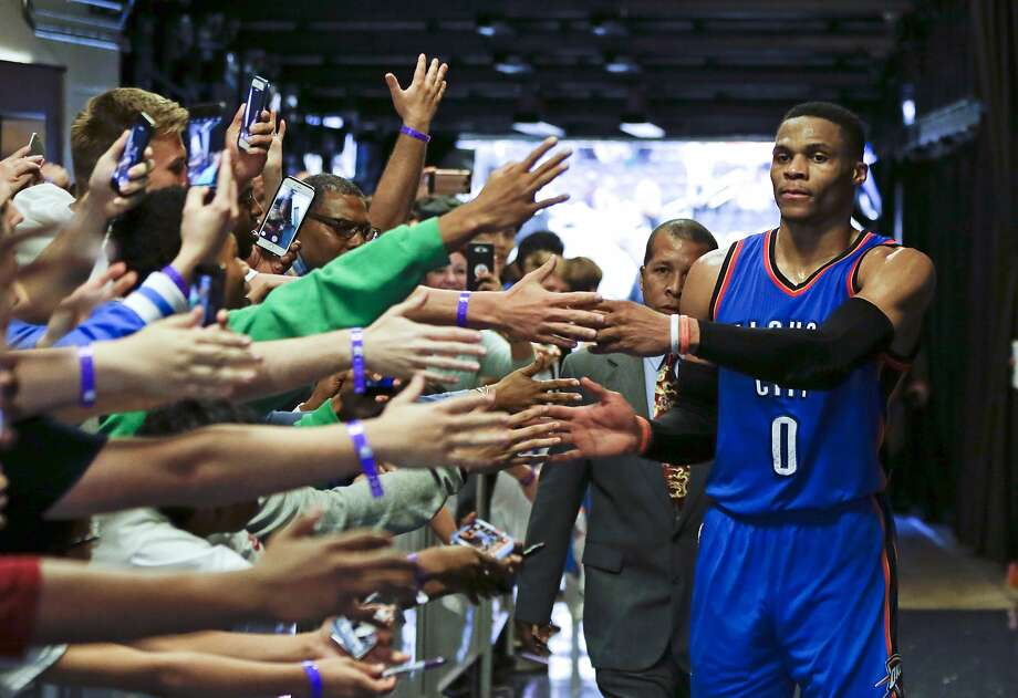 Oklahoma City Thunder's Russell Westbrook (0) is greeted by fans as he leaves the court after an NBA basketball game against the Orlando Magic, Wednesday, March 29, 2017, in Orlando, Fla. Oklahoma won 114-106 in overtime. (AP Photo/John Raoux) Photo: John Raoux, Associated Press