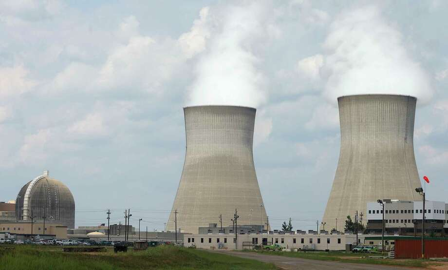 FILE - Cooling towers, right, and nuclear reactor containment buildings area, left, at Plant Vogtle Nuclear Power Plant in Waynesboro, Ga. The future of a number of billion-dollar nuclear projects under construction, including two in the U.S., is in question following cancellations and bankruptcies in 2017. See what would happen to Texas if a nuclear collapse occurred. Photo: John Bazemore, STF / Copyright 2017 The Associated Press. All rights reserved.