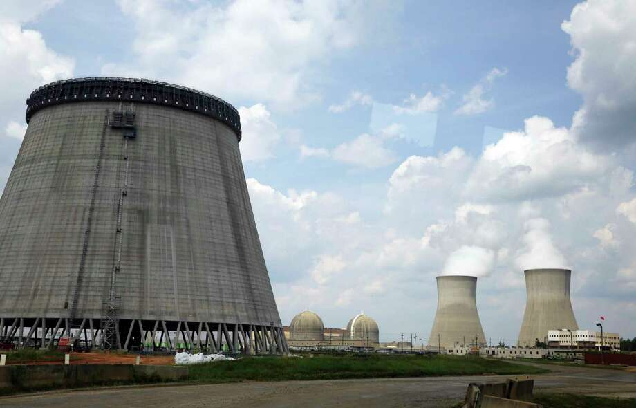 A cooling tower for a nuclear reactor goes up in 2014 in Waynesboro, Ga. Westinghouse Electric Co. reactors are being used at the Vogtle plant. Westinghouse filed for Chapter 11 bankruptcy last week. Photo: John Bazemore, STF / Copyright 2017 The Associated Press. All rights reserved.