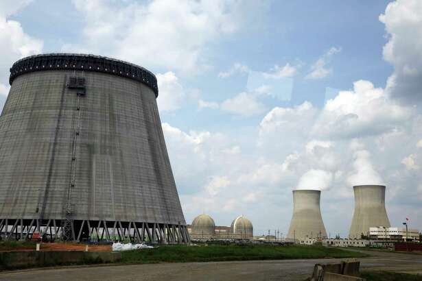 A cooling tower for a nuclear reactor goes up in 2014 in Waynesboro, Ga. Westinghouse Electric Co. reactors are being used at the Vogtle plant. Westinghouse filed for Chapter 11 bankruptcy last week.