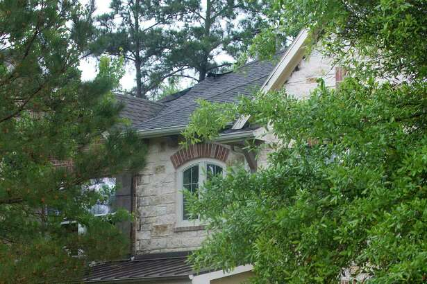 Fire officials are confident a lightning strike ignited a two-story brick home in Spring Wednesday, whose owners planned to sell soon.
