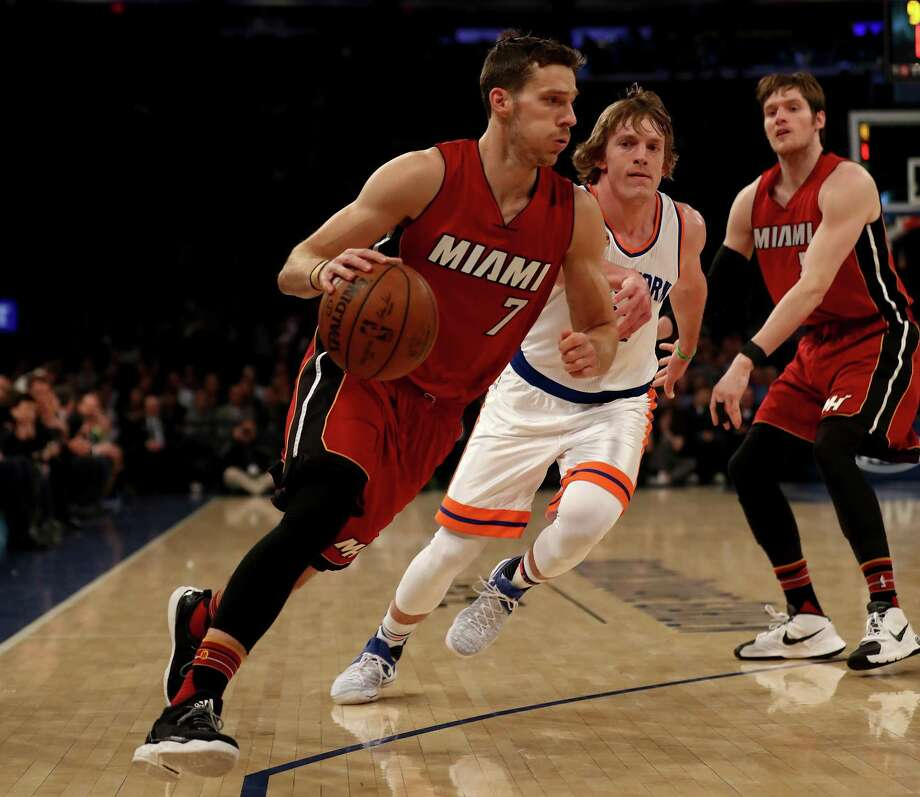 NEW YORK, NY - MARCH 29:  Goran Dragic #7 of the Miami Heat heads for the net as Ron Baker #31 of the New York Knicks defends at Madison Square Garden on March 29, 2017 in New York City. NOTE TO USER: User expressly acknowledges and agrees that, by downloading and or using this Photograph, user is consenting to the terms and conditions of the Getty Images License Agreement  (Photo by Elsa/Getty Images) ORG XMIT: 662357453 Photo: Elsa / 2017 Getty Images