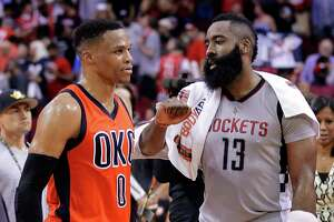 With his left wrist wrapped, James Harden, right, takes time after Sunday's Thunder game to talk with fellow MVP candidate Russell Westbrook.