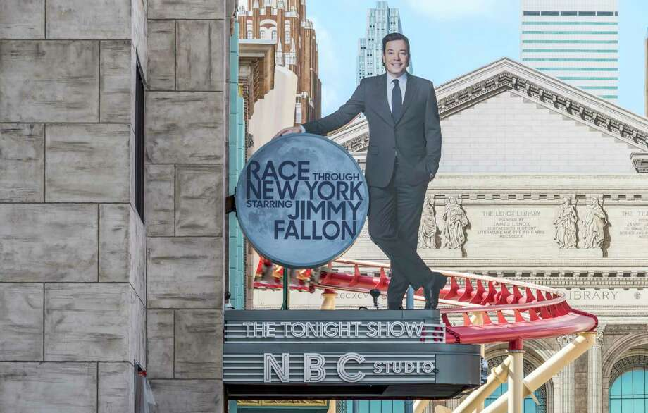 """This undated photo made available by Universal Orlando Resort, shows the new """"Race Through New York Starring Jimmy Fallon"""" ride in Orlando, Fla. Universal is leading the theme-park charge into """"virtual lines"""" that give visitors options for exploring a park or watching live entertainment instead of the tedium of looking at someone's back as you inch forward step by step to the thrill ride. (Universal Orlando Resort via AP) ORG XMIT: MH101 / Universal Orlando Resort"""