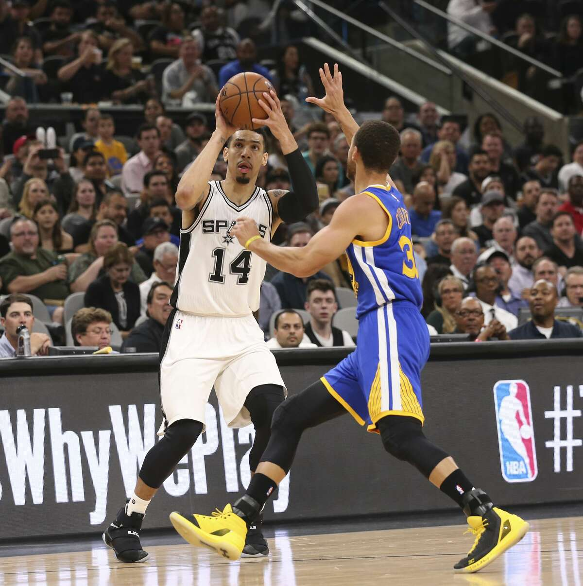 San Antonio Spurs?' Danny Green lines up a three-pointer as Golden State Warriors' Stephen Curry defends during the first half at the AT&T Center, Wednesday, March 29, 2017.